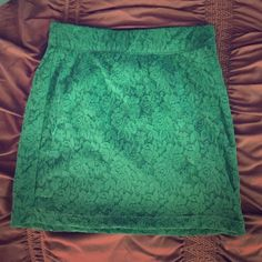 Lace detailed High-waisted skirt Love the lace and color of this skirt, perfect for getting yourself exciting for Spring and putting some color back into that wardrobe! Elastic waistband for comfort and easy for, great paired with a crop top or something flowing and tucked in! In great condition, only worn once or twice. The color is a really pretty tealish-green! Nollie Skirts