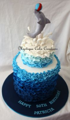 Double barrel, ombre ruffled, dolphin cake. Made by Mystique Cake Creations. Perth WA
