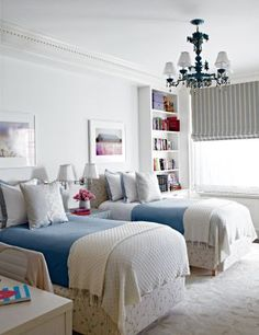 Traditional Children's Room by Gomez Associates Inc. in New York.In a children's room in Tracy Pollan and Michael J. Fox's Manhattan apartment, sconces from Remains Lighting are mounted between Charles H. Beckley beds upholstered in a Fabricut linen. PHOTO: William Abranowicz; HOMEOWNER: Tracy Pollan and Michael J. Fox; ARTICLE: Family Wise, December 2012