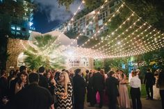 Outdoor Cocktail Hour at the beautiful garden under the bistro lighting | wedding | Cocktail Reception | Woman's Club of Coconut Grove | Photo Courtesy of Evan Rich Photography