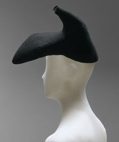Black wool felt hat by Elsa Schiaparelli, French, winter 1937-38. Schiaparelli's collaboration with Salvador Dalí reached the height of Surrealist absurdity in this high-heeled shoe from winter 1937–38.
