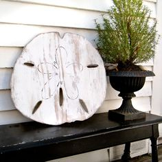 wooden oversized sand dollar beach decoration- this would be adorable on my porch