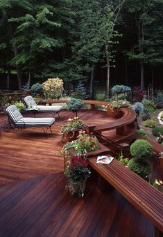 custom deck perfectly compliments this backyard.