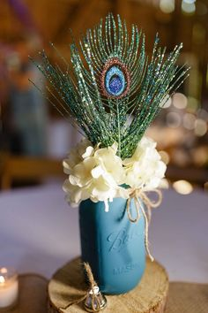 See the source image Mason Jar Centerpieces, Mason Jars, Teal Accents, Peacock Wedding, Wedding Table Decorations, Blue Tones, Accent Colors, Wedding Details, Our Wedding