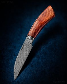 "Maker: Kyle Royer, MS Facebook: facebook.com/KyleRoyerKnives Website: kyleroyerknives.com 4"" Wharncliffe blade of tight W twist damascus. Stainless steel Kyle Royer engraved spacer. Curley koa sculpted handle. 8"" overall.  #knife #knifecommunity #handmade #knives #customknives #knifepics #handmadeknives #calebroyerphotography #knifeart #knifemaking"
