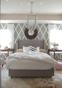 Cool walls, chandelier, and a great mirror. Calming greys and whites are great for bedroom colors!