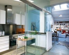 open kitchen with glass sliding doors