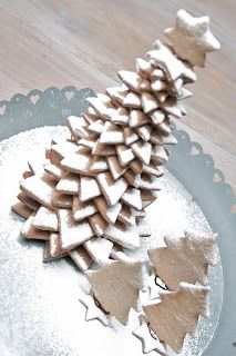 Gingerbread star cookie tree with powdered sugar snow...