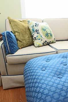 """The custom upholstered ottoman in """"FULL"""" shows the depth a matelasse fabric can add."""