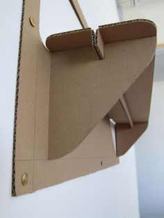 aha - it's the bit that folds down which is creased in the middle and slots into the groove of the shelf support! Display Shelves, Shelving, Display Ideas, Shelf Supports, Cardboard Furniture, Single Piece, Storage Solutions, House Ideas, Middle