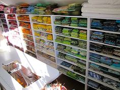 "sort fabrics by colors on shelves.  I can add this to the ""already done this"" board."
