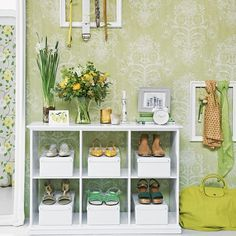 We love the mix of gorgeous green wallpaper and lime green accessories in this bedroom corner