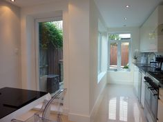 Side return in Richmond, created new dining space in what used to be the side return and extended the kitchen along the opposite wall, with deep seat in side window to perch on