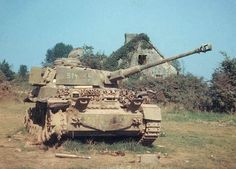 Rare color photograph of a camouflaged Panzer IV knocked out in Normandy in 1944. From the markings and camouflage, the Panzer IV appears to be from the German Panzer Lehr Division.