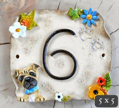This beautifully hand made ceramic house sign is personalised with your house number. Choose to add your own pets with dogs and cats to House Address Numbers, House Numbers, Ceramic Houses, Home Signs, Garden Art, Diy And Crafts, Kids Rugs, Pets, Handmade Gifts