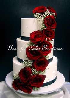 Elegant White Butter Cream Wedding Cake with Black Ribbon and Pearls with a Cascade of Red Roses
