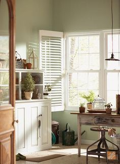 Decorate with a Pastel or Neutral Color. Behr's Topiary Tint feels fresh and bright in this mudroom. We love the way it picks up on the soft greenery outside the window! Neutral Color Scheme, Color Schemes, Home Living, Living Spaces, Kitchen Living, Estilo Country, Sweet Home, Interior And Exterior, Interior Design