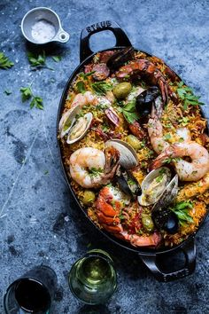 Paella Party 101 - The Entertaining House. Image via Half Baked Harves t Paella is like a party in a pot. This seemingly sophisticated one pot meal traces its humble roots to the coastal town of Valencia,Spain in the Paella, pronou Fish Recipes, Seafood Recipes, Cooking Recipes, Healthy Recipes, Seafood Paella Recipe, Octopus Recipes, Seafood Pasta, Spain Paella Recipe, Paella Recipe For 2