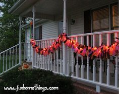 "Outdoor Halloween Garland: 14' String orange lights, 1ea black, purple & orange disp. vinyl tabecloths 54""x108"". Cut in ruler size strips & tie on lights. *Do 4 any holiday. :)"