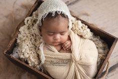 baby girl wearing neutral colors, 6 weeks old
