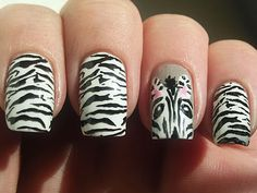 */ Peeking Zebra Nails..would be cuter with only one nail as zebra face and on other hand with one nail zebra butt! haha