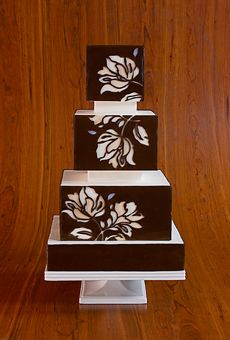 A Square, Brown Wedding Cake. A Graphic, Chocolate Wedding CakeGraphic, cutout white flowers are an unexpected detail on this Elegantly Iced wedding cake. So sharp and modern!See more modern wedding cakes.Photo: Courtesy of Elegantly Iced Brown Wedding Cakes, Square Wedding Cakes, Wedding Cake Photos, Wedding Sweets, Amazing Wedding Cakes, Wedding Cakes With Flowers, Elegant Wedding Cakes, Wedding Cake Designs, Wedding Cake Toppers