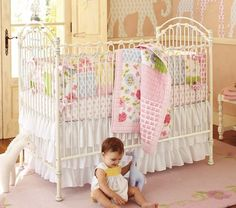 Such a pretty crib-vintage look, made of iron! Cool! Too bad we already have a beautiful crib-when #2 comes around we'll likely just re-use that one, but a girl can dream ;)