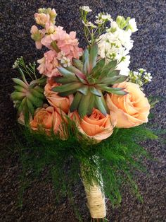 Stock, peach roses, succulents and filler flowers