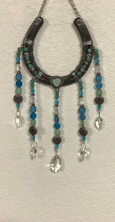 Excited to share this item from my shop: Sun Catcher Horseshoe Sun Catcher Garden Art Patio Decoration Crystal Suncatcher Turquoise Decorated Horseshoe Horse Lover Lucky Horseshoe Projects, Horseshoe Crafts, Horseshoe Art, Beaded Horseshoe, Horseshoe Ideas, Lucky Horseshoe, Diy Wind Chimes, Horse Crafts, Horse Bits