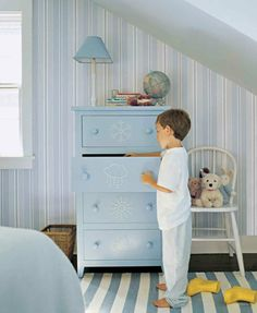 Personalize a dresser in a child's room with playful, pointillist motifs made with upholstery nails. The pictures can help kids remember where items belong (T-shirts go in the sun drawer, sweaters in the snowflake drawer). #KidsRoom #ChildrensBedroom #HomeDecor #InteriorDesign #HomeDesign #HomeStaging #RealEstate #SeattleRealEstate #SeattleRealtor #SeattleHomes