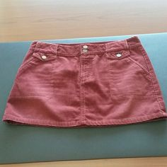 American Eagle corduroy mini Super cute corduroy mini skirt in excellent used condition. The color is burgundy/wine.  Soft and comfortable this skirt would make a great addition to your closet! American Eagle Outfitters Skirts Mini