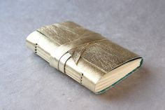 Gold Leather Journal or Sketchbook. $25.00, via Etsy. For my endless to-do lists!!! Love it!