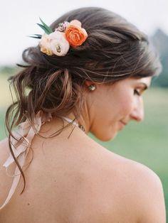 sweep rustic ranunculus into a messy bridesmaid wedding bun for boho hair vibes