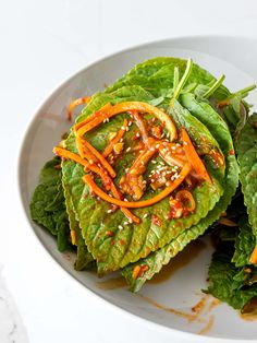 This Korean perilla leaf kimchi is a simple Korean side dish made with marinated perilla leaves in soy sauce Korean Side Dishes, Healthy Side Dishes, Korean Red Pepper Flakes, Easy Korean Recipes, Herb Salad, Low Sodium Soy Sauce, Shredded Carrot, Steamed Rice, Korean Food