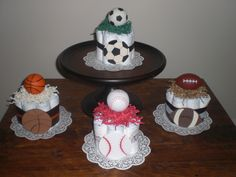 Sports Diaper Cake baseball, soccer, basketball, football baby shower centerpieces - http://www.babyshower-decorations.com/sports-diaper-cake-baseball-soccer-basketball-football-baby-shower-centerpieces.html