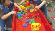 Flood by Thomas Bedard. Two separate operations are going on in this video.  The children at the bottom are building a structure with duplos.  The children at the top are filling a 5-gallon bucket with water to sent crashing down on the structure the children are building at the bottom.  The excitement in the video is palpable at the point where the water crashes down the the structure.