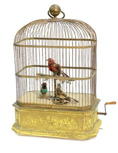 *VICTORIAL SINGING BIRD AUTOMATON MUSIC BOX: the gilt + wire cage housing three birds w/ one on a perch, the two lower birds both sing and move well, raised on a gilt base w/ floral + acanthus detail.