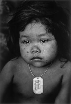 Cambodian Refugee Girl, Phnom Penh, 1975 by Ansel Adams. What I like about is the emotion capture is this picture. The sadness in the little girl eyes, the tears on her face, and maybe past family member dog-tag around her makes me think she is sad. Despite all of that I think this was a great cannon shot.