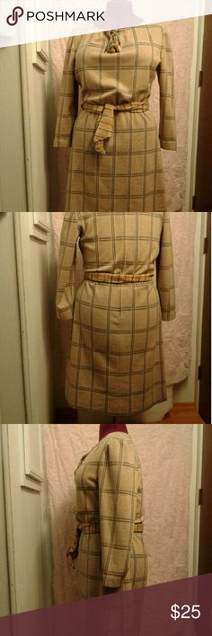 Vintage knit windowpane pattern dress sz 12 Beautiful tan vintage dress with blue and brown windowpane check pattern. Heavy double knit, as used in the seventies. Drawstring neckline. It originally came with a shiny green cord, but I made a Drawstring to match and put bobbles on the end  Word of caution: you do not want to pull tightly on the Drawstring or it will break, but it isn't necessary to pull at all, just tie. Wear with or without a belt. Sash not included. I bought from Etsy. No…