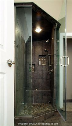 bathroom shower remodel ideas slate  Love the stone/tile and cut outs for shampoo/Etc.