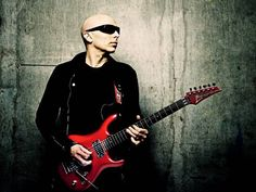 Joe Satriani (We're not sure we could take the excitement, but we're willing to try.  Say the word Joe...)