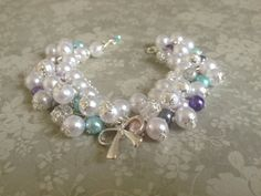 Cute bracelet from beads with ribbon by EwelinArt on Etsy
