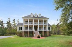 GARDNER REALTORS Mansion Monday: Take a look at this stately Houmas House look-alike located on 3.3 peaceful, wooded acres in Madisonville's gated Claiborne Oaks subdivision.