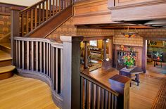 Craftsman Staircase with Hardwood floors, interior wallpaper, Wainscoting, High ceiling