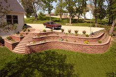 backyard retaining wall, with tiered garden Retaining Wall Steps, Backyard Retaining Walls, Backyard Patio, Steep Hillside Landscaping, Home Landscaping, Front Yard Landscaping, Sloped Garden, Landscape Walls, Yard Design