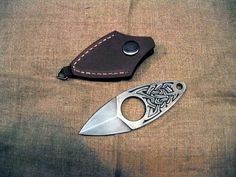 This adorable little push-dagger! Can I wear it up my sleeve somehow?? So cute!
