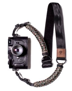 Originally used in the suspension lines of US parachutes during World War II, test paracord flexes but will never break. Worn around your neck or as a sling, the strap's suspension shields your Paracord Camera Strap, Camera Straps, Photography Accessories, Photography Gear, Camera Accessories, Other Accessories, Camera Backpack, Camera Bags, Camera Aesthetic