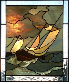 Stained glass panel of Sailboats in a stormy sea