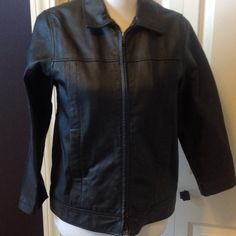 Wilson Leather Black Jacket Side slit pockets. Zipper front. Zipper pulling away at the very bottom of the jacket - just needs to be tacked back in. Jacket still zips fine and that isn't even noticeable when being worn. Sized as a kids XL but fits an adult small Wilsons Leather Jackets & Coats