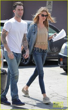 Adam Levine & Behati Prinsloo. Can she NOT find a shirt that fits???